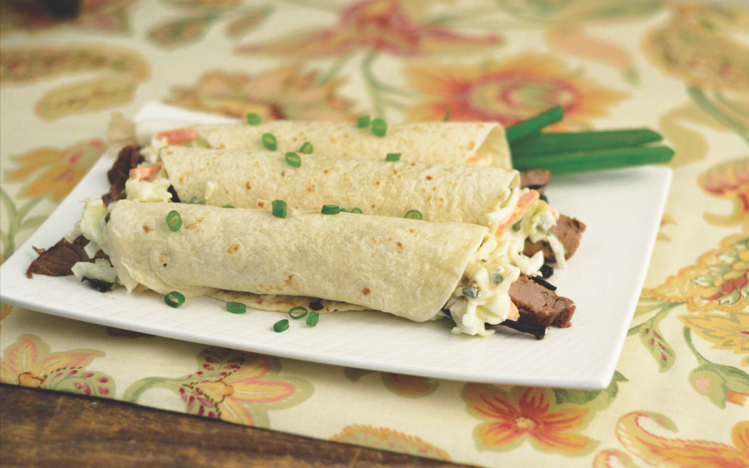 BAJA STEAK TACOS WITH GRILLED SPRING ONIONS AND JALAPENO SLAW